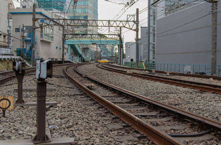 railway transportation: Tokyo, Japan - railroad tracks. Railway transportation infrastructure with electric lines.