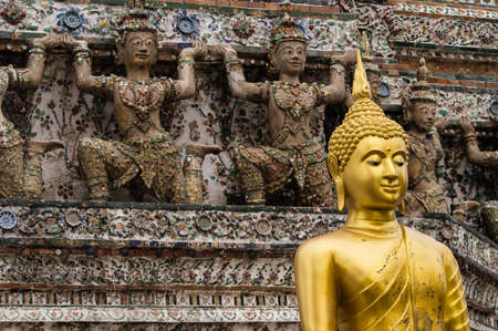 Thai Buddha in front of a stupa. photo