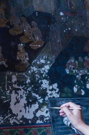 restoring: Artist Restoring a Painting