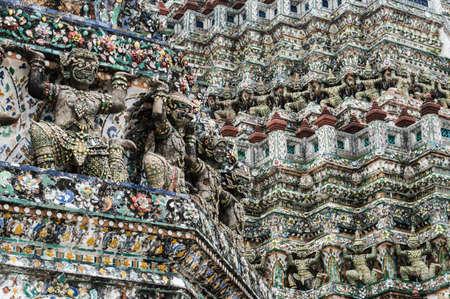 The gargoyles on the stupa of Wat Arun in Bangkok. Location: Wat Arun, the Temple of Dawn, Bangkok, Thailand. photo
