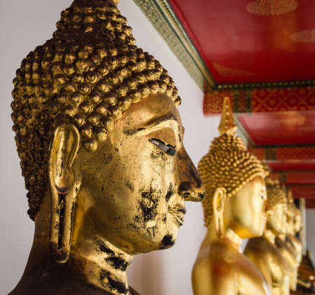Buddha in Wat Pho Temple sequential nicely in Bangkok, Thailand photo