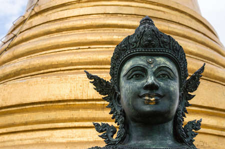 Buddha statue in Wat Saket, Golden Mount Temple, sits on a artificial hill. Its a buddhist temple and a famous landmark of Bangkok Thailand photo