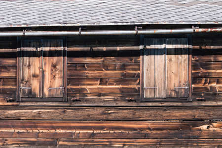 Wooden Hut in Austria with shutters closed. photo