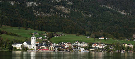 wolfgang: View of View of St. Wolfgang chapel and the village waterfront at Wolfgangsee lake, Austria