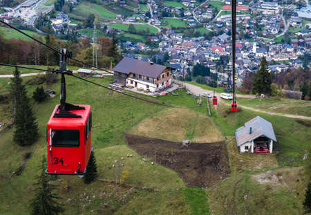cabel: View from Zwolferhorn on Wolfgangsee and St. Gilgen with cabel car in Austria