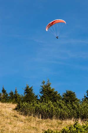 Extreme parachuting in high mountains Alps Austria photo
