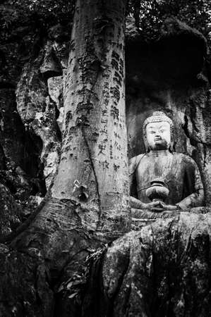Feilai Feng grottoes with fine buddhist stone carvings. It is called photo