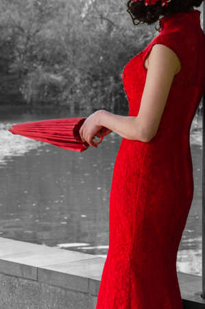 classic chinese woman beauty holding umbrella by the lake photo