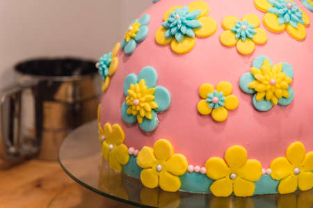 suger: Homemade Birthday Cake with Flowers made of Icing Suger. Stock Photo