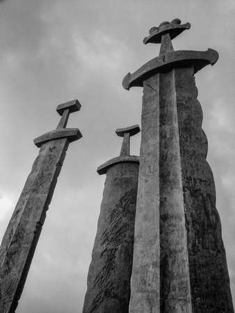 hill of the king: Three large swords stand on the hill as a memory to the Battle of Hafrsfjord in year 872, when King Harald Fairhair gathered all of Norway under one crown. Stock Photo