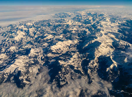 The Austrian Alps in Tyrol seen from above under a beautifull blue sky.