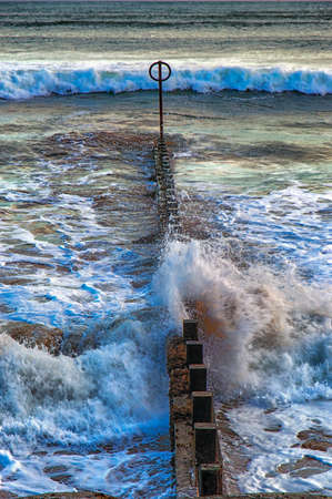 groyne: Tide Coming in on the beach of Aberdeen,Scotland Stock Photo