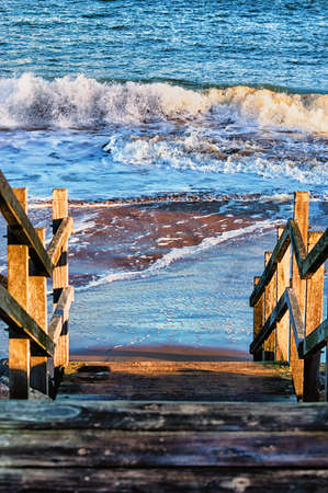 Wooden stairs on deserted beach, Aberdeen, Scotland photo