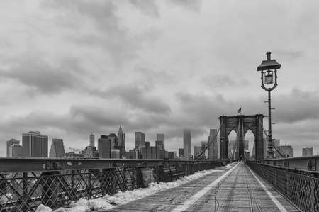 boroughs: The Brooklyn Bridge connects Manhattan to Brooklyn across the East River and was opened in 1883. Stock Photo