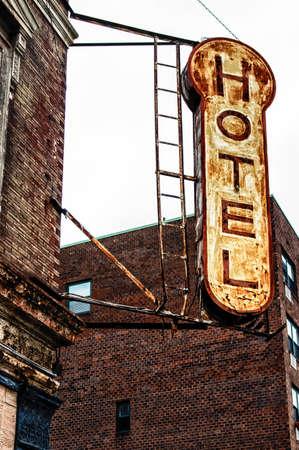 decrepit: Old, decrepit, weathered sign for a hotel