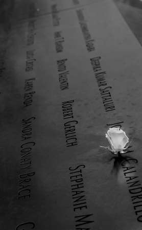 White Rose left at the National 911 Memorial at Ground Zero. The flower commemorates the birthday of a victim of the attacks of 2001 in Lower Manhattan on April 26, 2014.