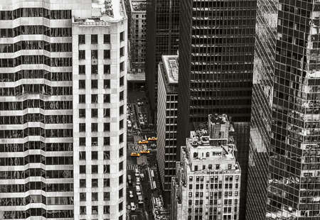 directly below: A high angle view of pedestrians and traffic on the streets of Manhattan.