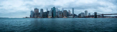 Panorama New York City over the East River towards the financial district in the borough of Manhattan. photo