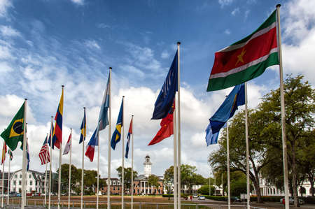 Flags of different countries of the historic city of Paramaribo, Suriname. photo
