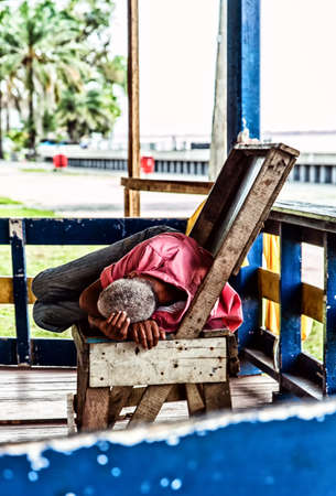 ramble: male homeless sleeping on a bench