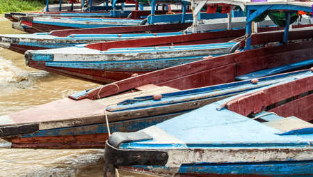 suriname: boats on the banks of the Commewijne river in Suriname. Stock Photo