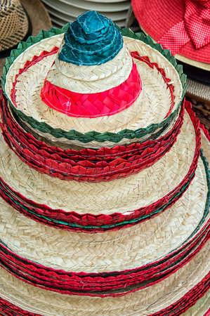 37966509 - Una colorida pila de sombreros mexicanos tradicionales para la  venta 7728eaadc1b