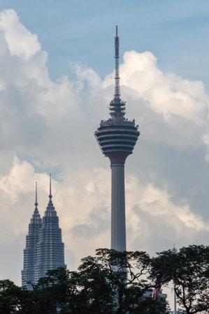 kl: Two symbols of Kuala Lumpur - KL Tower and Petronas Twin Towers.