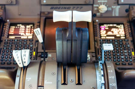 Detail of Cockpit controls inflight of a commercial airliner Фото со стока