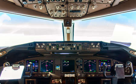 Detail of Cockpit controls inflight of a commercial airliner Stock Photo