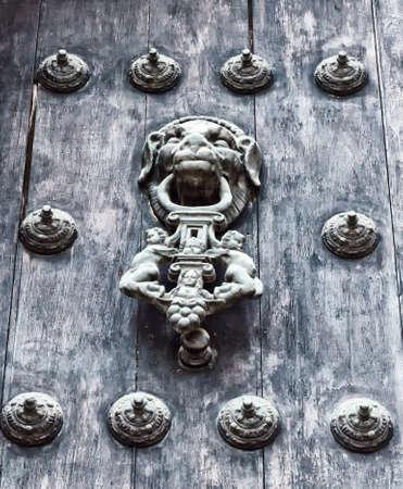 antique door knocker in Lima, Peru photo