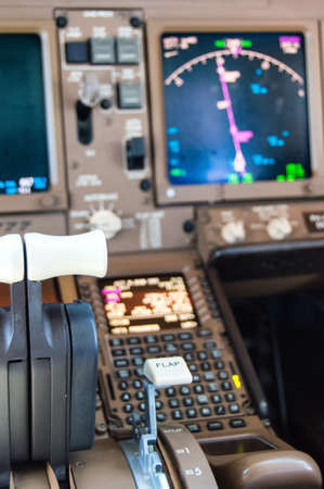 throttle: Detail of Cockpit controls inflight of a commercial airliner Stock Photo