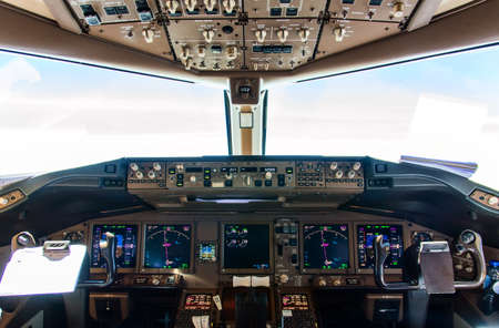 controls: Detail of Cockpit controls inflight of a commercial airliner Stock Photo