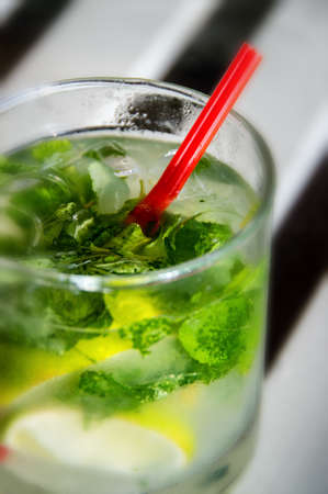 red straw: A Refreshing Mojito cocktail with red straw Stock Photo