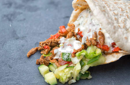 yiddish: Pita filled with shoarma vegetables and garlic sauce  on a plate Stock Photo