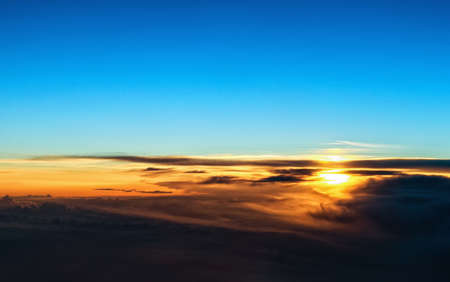 Beautiful sunset above the clouds photo