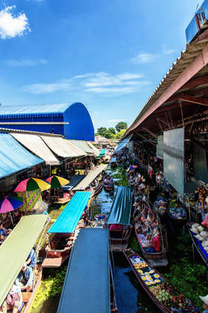 loc: RATCHABURI THAILAND  JUNE 192015: People visit Damnoen Saduak floating market. around a 100kms southwest of Bangkok Damnoen Saduak Floating Market is one of the most attractive destinations to tourists to Ratchaburi Every morning there are hundreds of loc Editorial