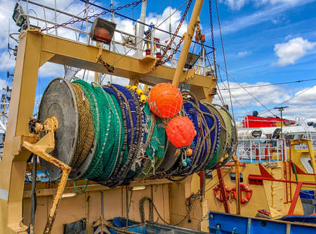 trawler: Fishing nets gathered at the stern of a trawler Stock Photo