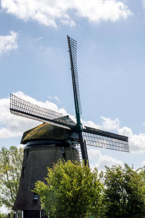 dutch culture: Traditional windmills in dutch landscape in the Netherlands Stock Photo