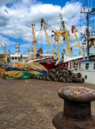 trawler: fishing trawler and nets in the harbour