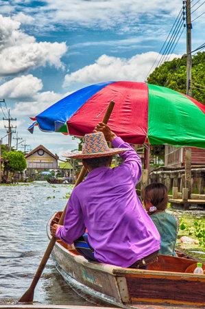sunday market: RATCHABURITHAILANDJUNE 19 : Unidentified People and Tourist on the boat tour Damneonsaduak Floating Market on June 19 2015 in RatchaburiThailand.