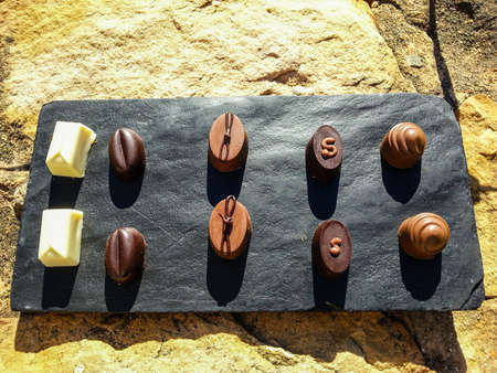 pralines: A plate with pralines in the sun Stock Photo