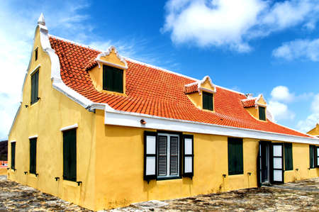 slaves: Savonet, Curacao - March 25, 2015: Bright yellow historic plantation house on Curacao. The building was build around 1660 by dutch colonists and many slaves used to work on the plantation. The building stands in Savonet, next to the Christoffel Park.