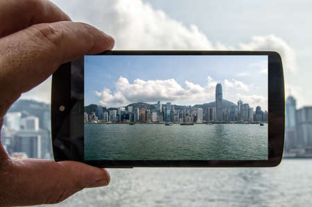 hong kong island: Making a Picture with a Mobile Phone of Hong Kong Island Famous Skyline