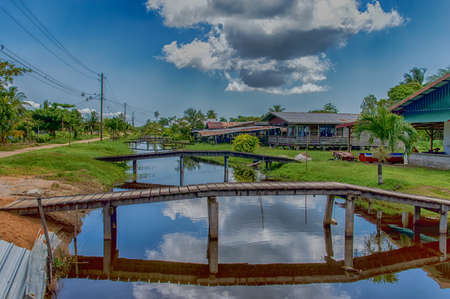 Housing and bridges at Rust en Werk plantation, Suriname