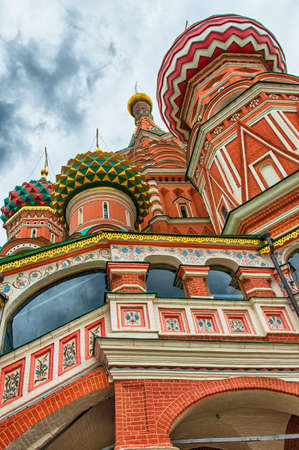 st basil s cathedral: Multi-colored domes of the main Orthodox church in Moscow - St. Basils Cathedral, a bright autumn day