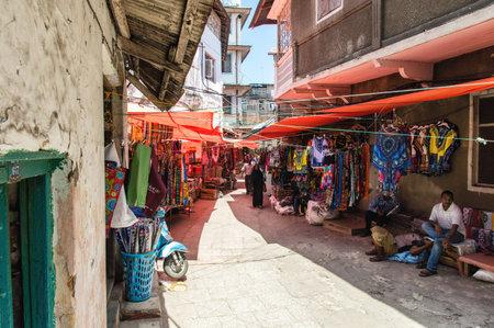 zanzibar: Stonetown, Zanzibar, Tanzania - September 22th 2015: People going about their daily business in Stonetown market, on the island of Zanzibar Editorial