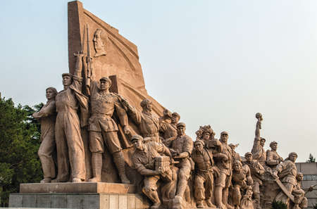Commemorating statues of workers in struggle in the revolution of China located near mausoleum of Mao Zedong, Beijing. China.