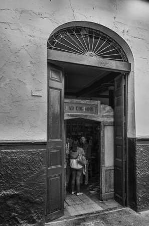 socializing: Street photography- Local People Socializing at Traditional Peruvian Bar Editorial