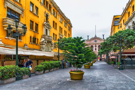 peruvian culture: Lima, Peru - November 01, 2015: Jiron de la Union; a pedestrian only street in the historic centre of Lima. The street is lined with old historic buildings and colonial architecture. The street dates back to 1535 when it was designed by Francisco Pizarro,