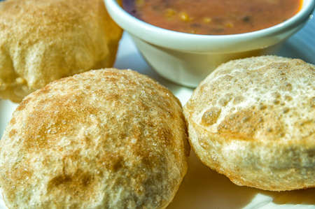 puri: Poori or puri also known as Indian fried bread, selective focus